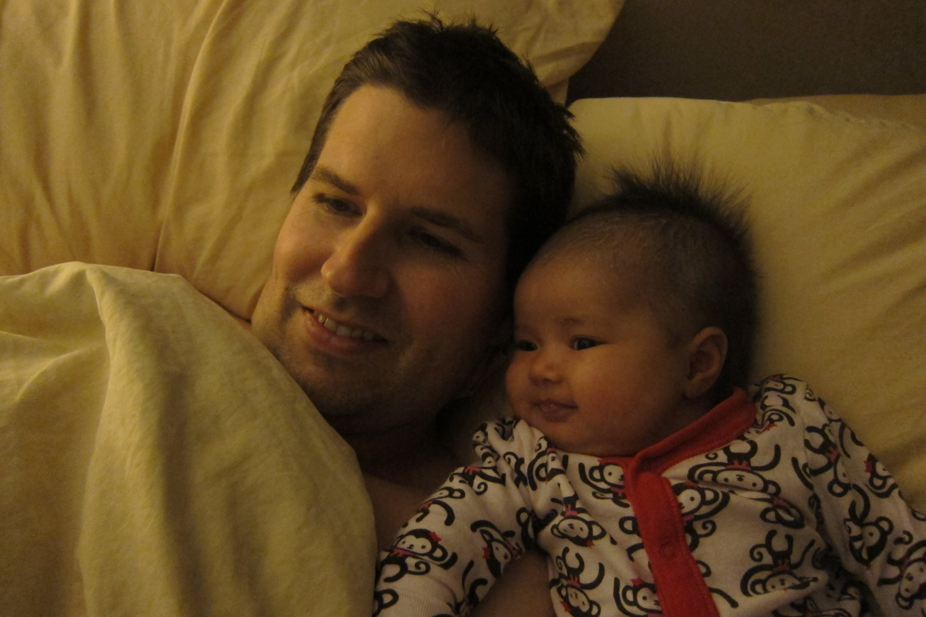 2012: Cuddling with Addy (2 mos)
